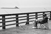 Coney Island fisher — Stock Photo