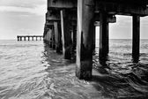 Under a pier on the beach at Coney Island — Stock Photo