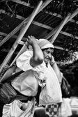 Stall carrier woman — Stock Photo