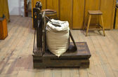 Antique scale with sack — Stock Photo