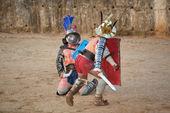 Thracian gladiator on knees — Stock Photo