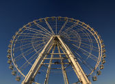 Ferris wheel on blue sky — Photo