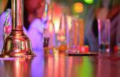 Bell over a counter bar  — Stock Photo