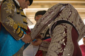 Bullfighter getting dressed — Stock Photo