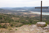 Catholic cross over Alcarria landscape — Stock Photo