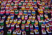 Bus figurines for sale at Chichicastenango market Guatemala — Stock Photo