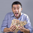 Exultant Young Man holding Banknotes — Stock Photo