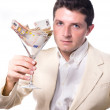 Businessman with Cocktail Glass full of Banknotes — Stock Photo #30385789