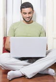 Happy Young Man Working on Laptop at Home — Stock Photo