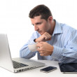 Businessman worried at his desk — Stock Photo #32030763
