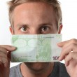 Man peering over a 100 euro banknote — Stock Photo #32032801