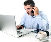 Businessman multi-tasking — Stock Photo
