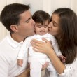 Mother and Father Kissing Daughter — Stock Photo