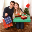 Young Happy Couple holding Christmas Presents — Stock Photo #35081549