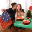 Young Happy Couple holding Christmas Presents — Stok fotoğraf