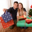 Young Happy Couple holding Christmas Presents — Foto de Stock