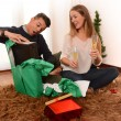 Young Happy Couple opening Xmas presents — Stockfoto