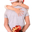 Young Couple hugging and Christmas Present — Stockfoto
