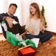 Young Happy Couple opening Xmas presents — Stock Photo