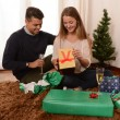 Young Happy Couple opening Xmas presents — Zdjęcie stockowe
