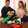Young Happy Couple opening Xmas presents — Stock Photo #35082263