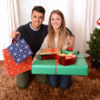 Young Happy Couple holding Christmas Presents — Stock Photo