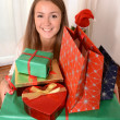 Young Beautiful Woman holding Christmas Presents — Stock Photo