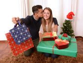 Young Happy Couple holding Christmas Presents — Stock fotografie