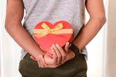 Man hidding Heart shaped Box Present — Photo