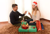 Young Happy Couple Champagne Christmas toast — 图库照片