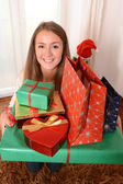 Young Beautiful Woman holding Christmas Presents — Stock fotografie