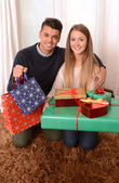 Young Happy Couple holding Christmas Presents — Stockfoto