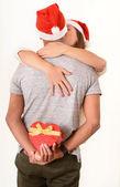 Young Couple hugging and Christmas Present — Stock Photo