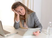 Young Business Woman stressed at work — Stock Photo