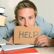 Stock Photo: Young Student Overwhelmed asking for Help