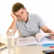 Stressed Student with Book and Laptop — Foto Stock