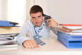 Overwhelmed Student pointing Gun to his Head — Stockfoto