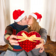 Romantic Young Happy Couple Christmas hats  kissing  — Foto de Stock