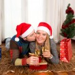 Young Happy Couple with Presents on rug at Christmas — Stock Photo #36136249