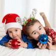 Stock Photo: Happy cute little kid and his sister at christmas