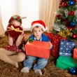 Happy Cute little kid Santa Claus hat and his beautiful sister — Stock Photo