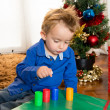 Happy cute little kid playing at christmas — Stock Photo