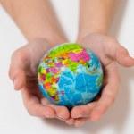 Kid holding little World Globe on her Hands — Stock Photo #36139055