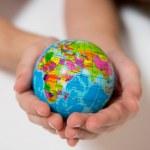 Kid holding little World Globe on her Hands — Stock Photo #36139105
