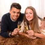 Happy Romantic couple on Rug — Stock Photo