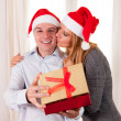 Romantic beautiful woman giving christmas present — Stock Photo