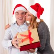 Romantic beautiful woman giving christmas present — Stock Photo #36139749