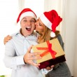 Romantic beautiful woman giving christmas present — Stock Photo #36139769