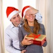 Romantic Young man giving christmas present — Stock Photo #36139787