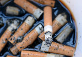 Ashtray Full of Cigarettes burnt butts — Stock Photo